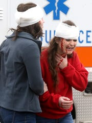 During a mock wreck Riverdale senior Rachel Cole, left, and junior Emily Musselm pretend to comfort each other during a wreck simulation on Tuesday, Feb. 14, 2017.