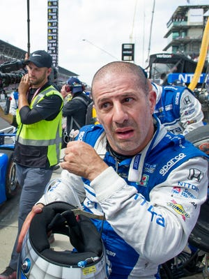 Chip Ganassi Racing IndyCar driver Tony Kanaan (10) sits on the pit wall after finishing fifth in the 101st running of the Indianapolis 500 at Indianapolis Motor Speedway, Sunday, May 28, 2017.