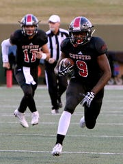 Wichita Falls High's Marcus King (9) rushes the ball