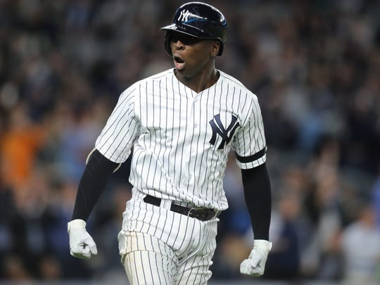 Didi Gregorius is shown celebrating immediately following