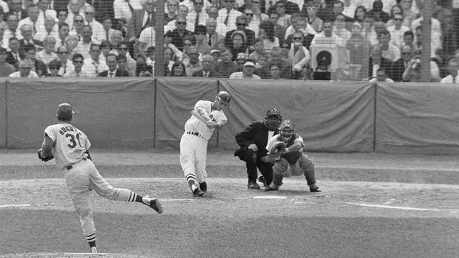Carl Yastrzemski homers at Fenway Park during Game 2 of the 1967 World Series. Mike Ryan helped the Red Sox to within one victory of a title.