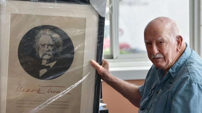 Curt Curtin holds one of the items from his extensive Mark Twain collection. He donated the collection to the Elmira College Center for Mark Twain Studies in upstate New York. Twain summered on Quarry Farm in Elmira, where he wrote some of his most famous works.