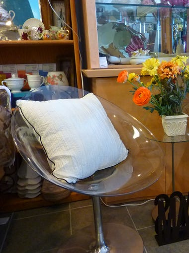 A peek inside The Spotted Couch, a consignment shop on Lake Pleasant Parkway in Peoria that just celebrated its third year. The shop specializes in furniture and home decor, including this pair of Italian Lucite swivel chairs.