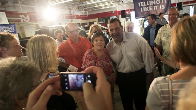 Toni Brandt of Ankeny has her photo taken with Presidential candidate Chris Christie following his town hall event on Saturday July 25, 2015 at Des Moines Area Community College in Ankeny, Iowa.