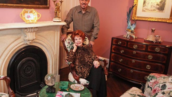 Actress Arlene Dahl and perfume bottle designer Marc Rosen in the Victorian parlor that sits just off the front door at Treetops.