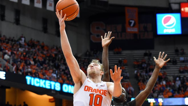 Syracuse guard Trevor Cooney (10) lays the ball in front of Lehigh Mountain Hawks guard Austin Price (5).