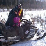 Christina Roalofs, an Alaskan dentist who graduated from U of L, is back for more in this year's Iditarod.