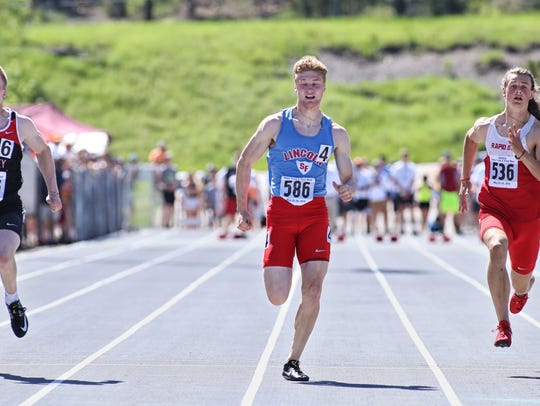 Braiden Petersen (left) edges Collin Brison (center) and Sage Hagen (right) in the Class AA boys 100m during the 2018 South Dakota State High School Track Meet at O'Harra Stadium in Rapid City, S.D.