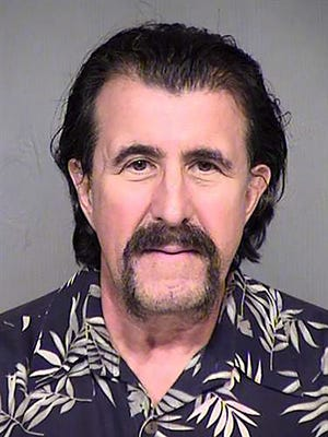 This Oct. 8, 2015, photo provided by the Maricopa County, Ariz. Sheriffs Office shows Sam Perone after his Thursday, Oct. 8, 2015 arrest in connection with a 1992 murder case in Ohio. Perone, 67, is being held pending extradition to Ohio for the suspected the slaying of 41-year-old furniture salesman Richard Woods of Lebanon, Ohio. ()