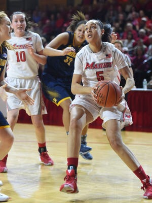 Marist College's Sydney Coffey gathers herself for a layup against Canisius on Feb. 27 at Marist.
