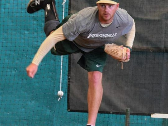 """Because of an injury suffered in the Navy, Brian Holcomb wears a carbon fiber """"IDEO: brace on his right leg. He did not wear it to pitch for Jacksonville University in his first career college baseball game on April 28."""