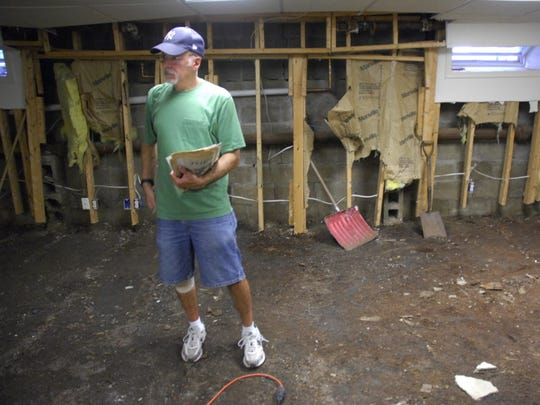 Greenwood Drive resident David Emma surveys his flood ravaged basement days after his South Mountain neighborhood in Millburn was inundated with floodwaters from the Rahway River Aug. 28, 2011, during Tropical Storm Irene.