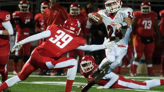 Lenape's Ryan Shuts (24) dodges Rancocas Valley's Sterling Pierce (39) during Friday's game in Mount Holly. The visiting Indians won the game 14-10, clinching the top seed in the South Jersey Group 5 playoffs. Lenape also won the West Jersey Football League Colonial crown.