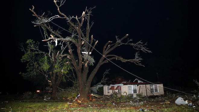 A home missing it's roof and trees that have been stripped bare are seen along State Highway 80 in Fruitvale, Texas, after a tornado swept through late Saturday, April 29, 2017. Fruitvale is north of Canton. Fatalities have been reported and dozens of people were taken to hospitals after a tornado hit the small city of Canton in East Texas, authorities said.