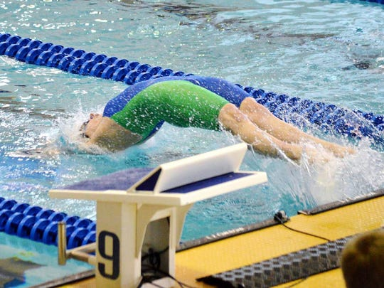 Lexington's Hannah Stevens, a junior at the University of Missouri, launches herself into the water. Stevens is bidding for a spot in the Summer Olympics in the 100 meter backstroke.