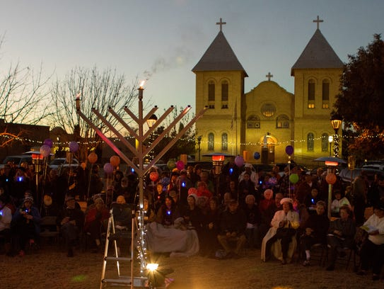 The lit Chanukah Menorah at the lighting ceremony held