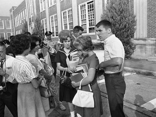 A student turns away in tears after African-American students were admitted to West End High in Birmingham, Ala., on Sept. 10, 1963.