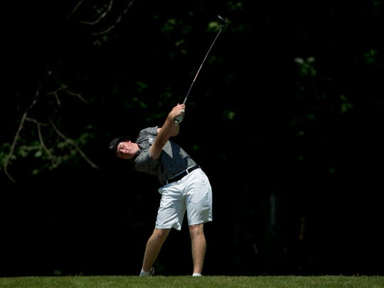 North's Stewie Hobgood drives from the 12th hole tee box during the IHSAA Boys' Sectional at Oak Meadow Country Club in Evansville Friday morning. Hobgood shot a 72 for fourth place individually and North came in first in the team category.