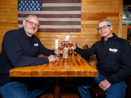 Founders, Jake Nunn (left) and Dwayne Mosley of Old Abe Brewing, enjoy a couple of their gluten-free beers at Beer Snobs in Hartland on Feb. 11, 2018.