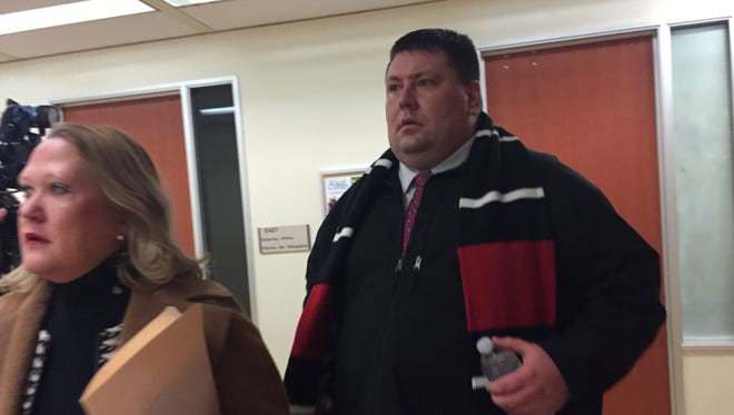 Former IMPD officer Nikolas Layton, 35, walks into court Thursday morning alongside his attorney, Jennifer Lukemeyer. Layton, who resigned as a police officer Tuesday, was arrested this week on preliminary drug charges.