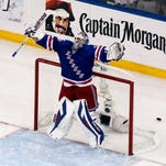 New York Rangers goalie Henrik Lundqvist (30) celebrates beating the Montreal Canadiens 1-0 in game six of the Eastern Conference Final of the 2014 Stanley Cup Playoffs at Madison Square Garden.