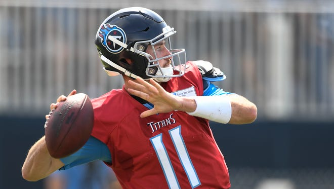 Titans quarterback Luke Falk (11) throws a pass during practice at Saint Thomas Sports Park Saturday, July 28, 2018, in Nashville, Tenn.