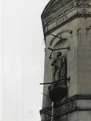 This statue of early Muncie businessman Charles Willard was on the side of the Willard Building at the corner of Main and Walnut streets in downtown Muncie until the structure was torn down in the 1960s.