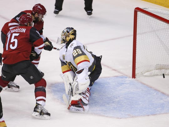 Arizona Coyotes right wing Tobias Rieder (8), left, scores a goal on Vegas Golden Knights goalie Marc-Andre Fleury (29) during the NHL home opener at Gila River Arena in Glendale on October 7, 2017.