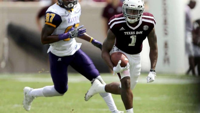 Texas A&M's Nick Harvey (1) breaks away from Prairie View A&M wide receiver Demarquo Lastrappe (87) for a 73 yard punt return for a touchdown during the second half of an NCAA college football game Saturday, Sept. 10, 2016, in College Station, Texas.