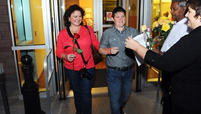 In this photo provided by the Las Vegas News Bureau, Ana Rendon and Michelle Guerra leave the Clark County Marriage License Bureau after receiving their marriage license Downtown Las Vegas on Thursday, Oct. 9, 2014. (AP Photo/Las Vegas News Bureau, Brian Jones)