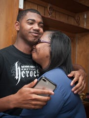 An'Darius Norwood, left, nominated his mother, Mashanda
