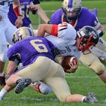 Mason Litz (6), Nick Gullett (44) and the Fowlerville defense gave up touchdowns on Eaton Rapids' first three series on Friday night.
