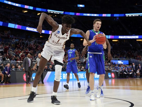 Florida State Seminoles forward Jonathan Isaac reacts