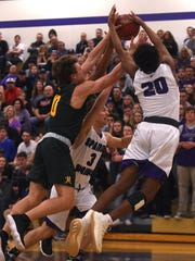 Spanish Springs' Cordell Stinson (20) fights for a rebound while taking on Bishop Manogue during their Northern 4A region boys basketball game at Spanish Springs on Feb. 16.