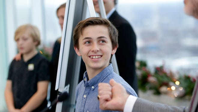 Flanked by his family, childhood cancer survivor Bennett Unger, 13, talks about the summer camp he attended  at Northwestern Mutual, Bennett is one of three childhood cancer survivors chosen to ride on Northwestern Mutual's 2018 Rose Parade float.