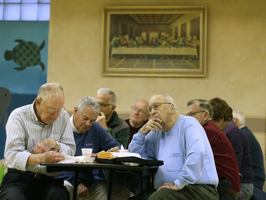 Frank VanLieshout, left, and Delmar Schuh, both of Appleton, participate in a session of the Fox Valley Bible Study Group Friday at St. Bernadette Catholic Church and School in Appleton. The study group has been gathering weekly for 38 years.