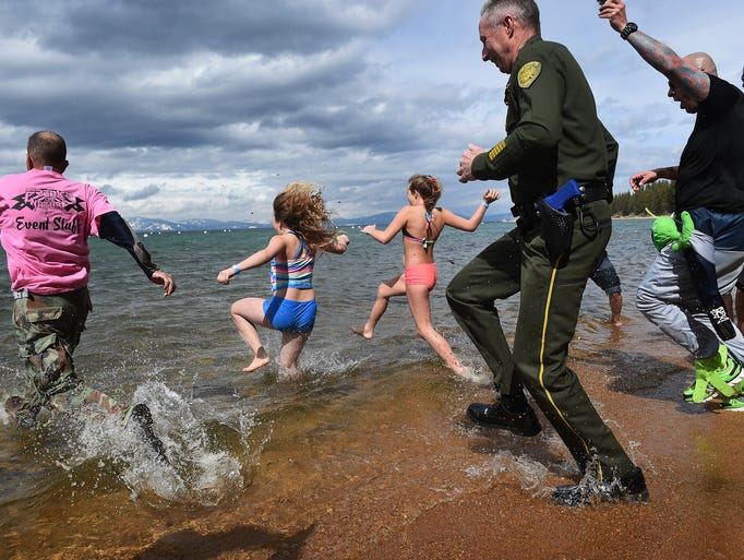 Brave swimmers, including members of multiple law enforcement