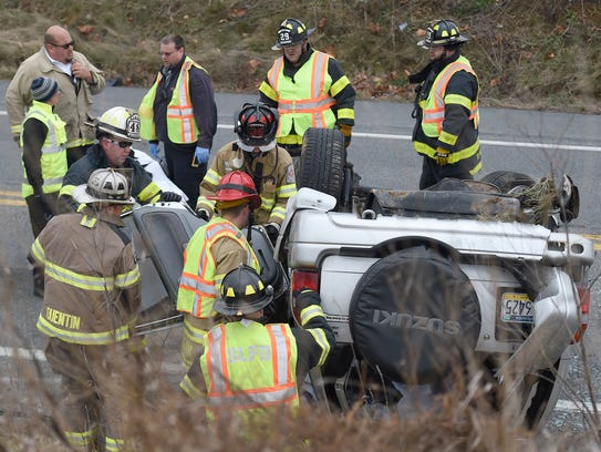 Firefighters had to free a woman trapped in her overturned