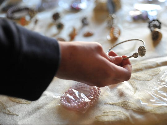 A student looks at jewelery available for the upcoming