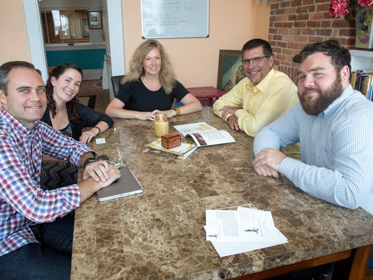 Muncie Civic Theatre's board members and staff Eric Jones, Leigh Carter-Edwards, Laura Williamson, Brian Hollars and Chris Griffith meet to discuss the renovation plans with the Star Press.
