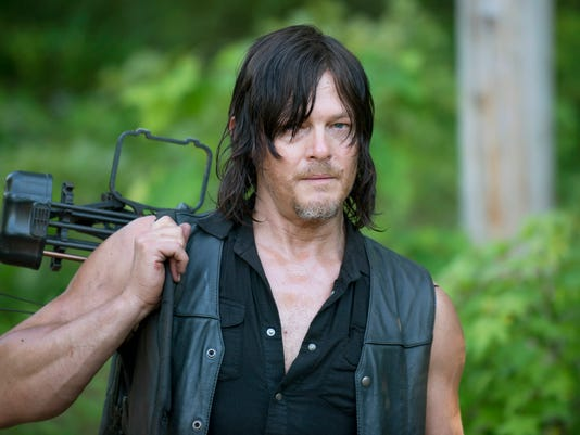 the walking dead tortures daryl introduces hit song