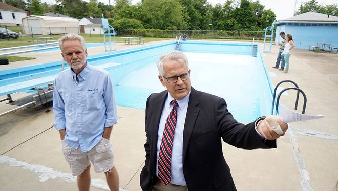 Mayor Tim Theaker addresses members of the media Tuesday morning and expresses the difficulty deciding to close tthe Linden Pool facility due to structural damage that could be dangerous.