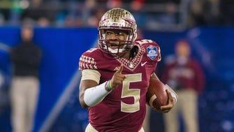Dec 6, 2014; Charlotte, NC, USA; Florida State Jameis Winston runs the ball during the second quarter against Georgia Tech.