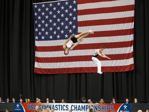 Gymnast warm up before the start of the elite competition of the USA Gymnastics Championships at the KFC Yum! Center in Louisville, Kentucky.       July 19, 2014