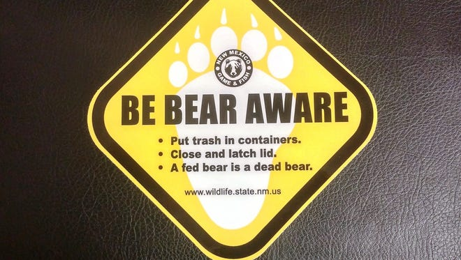Stickers to remind people to lock their dumpsters and not to feed the bears are being placed on the bins frequently targeted by the bruins.