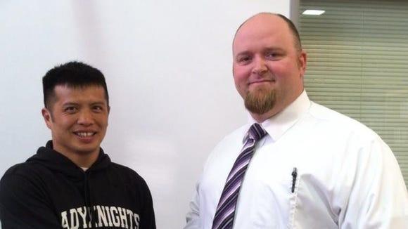 North Henderson girls track/wrestling coach Heang Uy and principal John Shepard.