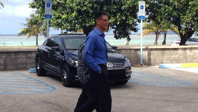 Franklin Babauta, a Guam National Guard lieutenant colonel, leaves the District Court of Guam on Tuesday, March 1, after a jury found him not guilty of taking part in a scheme to fraudulently collect bonuses through a National Guard recruiting program. Maria Hernandez/PDN