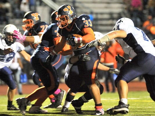 William Penn's Kelvin Nieves scores on a 3-yard touchdown run in the fourth quarter of Friday's game against Dallastown. The touchdown put William Penn on top, 29-22, erasing a 16-point halftime deficit.