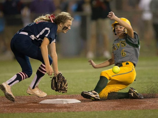 Calvary's Bailey Layton slides into second.