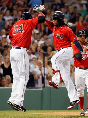 Boston Red Sox's Hanley Ramirez, center, celebrates his three-run home run that also drove in David Ortiz (34) and Xander Bogaerts, right, during the second inning of a baseball game against the Arizona Diamondbacks in Boston, Friday, Aug. 12, 2016.